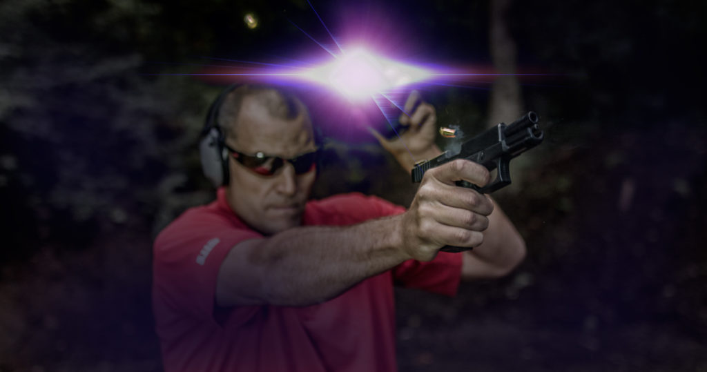 live fire at night with brass in the air shooting Glock 19